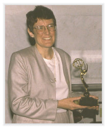 McCarthy recieves Emmy for research.